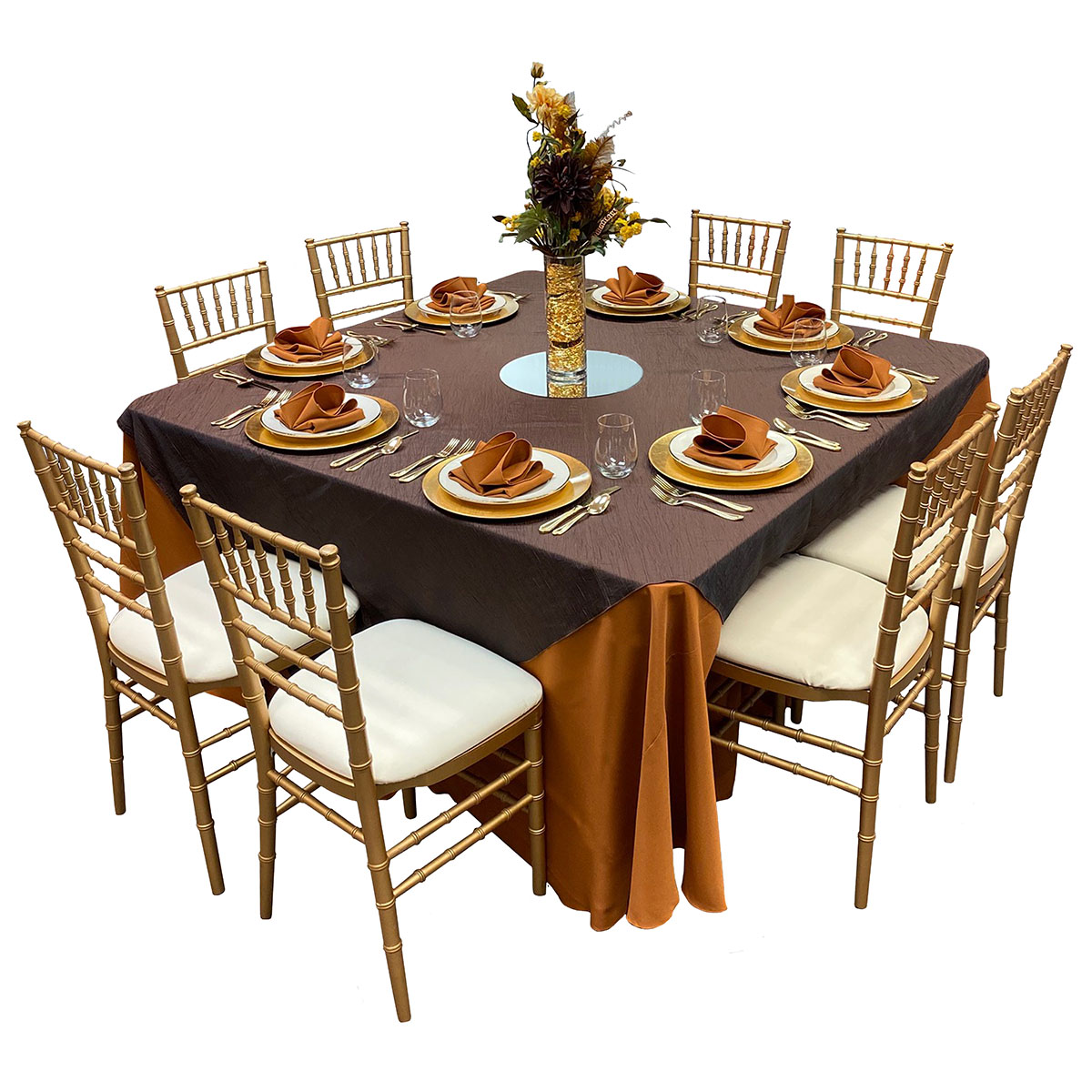 "Table 60x60 Wood Topped With 120"" Round Copper Solid Tablecover, 81x81 Krinkle Brown Topper, Brushed Gold Chargers, Beige With Gold Band China, Gold Plated Flatware, Stemless Wine White 17oz Glasses, Copper Solid Napkins, 4x12 Cylinder Vase, 14"" Round Mirror (Flowers Not Included)"