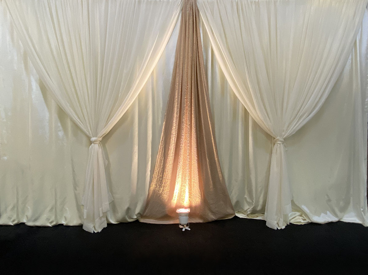 Ivory Bengaline Dual Panel Backdrop With Sheer Ivory Front Layer With Iridescent Crush Camel Accents With Uplights
